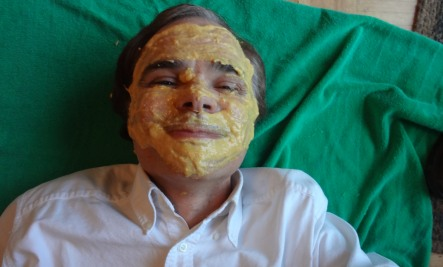 with mask on lying Randys Homemade Mango Mud Mask