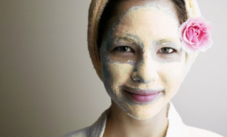 Woman with a mango mud mask
